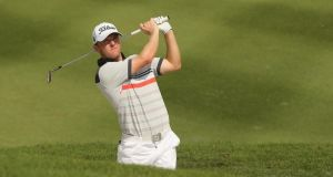 Michael Hoey of Northern Ireland in action during round one of the 2014 Maybank Malaysian Open at Kuala Lumpur Golf & Country Club in Malaysia. Photograph:  Ian Walton/Getty Images