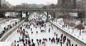 Commuting on the frozen Rideau Canal in Ottawa. Photographs: Getty