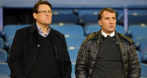 Liverpool manager Brendan Rodgers (right) and  his assistant Colin Pascoe watch Wednesday's  Crystal Palace win over Everton at   Goodison Park. Photograph:  Chris Brunskill/Getty Images