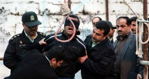 Convicted murderer Balal (C, with blindfold), who was sentenced to death for killing victim Abdolah Hosseinzadeh, shouting for mercy during   his execution in the northern city of Nowshahr, Iran. Media reports state that the execution of 19-year old Iranian murderer Balal was halted in the last minute by the parents of his victim. Photograph: Arash Khamooshi /EPA