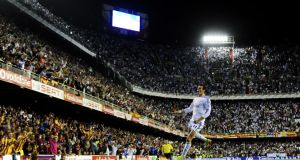 Gareth Bale celebrates after scoring a wonderful late goal to deliver Spanish Copa del Rey final for Real Madrid over great rivals Barcelona in Valencia. Dani Pozo/AFP/Getty Images