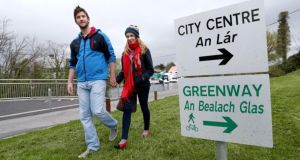 NUI Galway students Sarah Carthy and Shane Flynn on a section of the new greenway at the Fisheries Field in Galway city yesterday. Photograph: Joe O'Shaughnessy