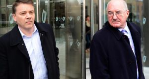 A composite image of former Anglo Irish Bank directors Pat Whelan (left) and Willie McAteer leaving Dublin Circuit Criminal Court after yesterday's guilty verdicts. Photograph: Eric Luke