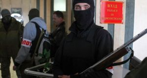 Pro-Russian armed men stand guard inside the mayor's office in Donetsk. Deep mistrust exists between the pro-Russian groups and the Western-backed government in Kiev. Photograph: Reuters