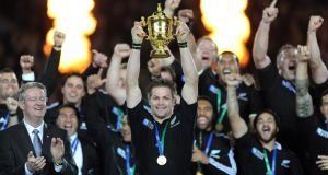 Winning line-up: Richie McCaw and the New Zealand squad with the Rugby World Cup trophy in 2011. Photograph: Andrew Cornaga/Photosport/Inpho