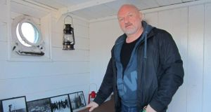 Ulf Bakke in Ernest Shackleton's former ship's cabin, which has been on his family's farm since the 1920s.