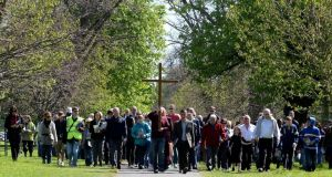The Way of the Cross procession makes its way through Dublin's Phoenix Park yesterday. Photograph: Cyril Byrne.