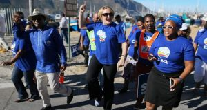 Helen Zille, leader of the opposition Democratic Alliance, dances with supporters at a campaign rally in Hout Bay, Cape Town, on Thursday. The main opposition party has steadily increased its support base since 1994. Photograph: Nic Bothma/EPA