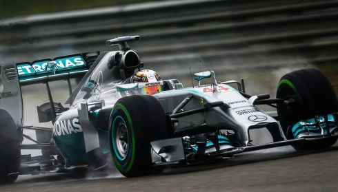 Lewis Hamilton behind the wheel.  Photograph: Diego Azubel/EPA
