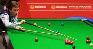 Ireland's Ken Doherty  in action against Stuart Bingham  during day one of the the  World Snooker Championship at The Crucible Theatre  in Sheffield. Photograph: Matthew Lewis/Getty Images