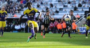 Swansea's Wilfried Bony fires home an injury-time penalty to score his second and the winning goal against Newcastle in the Premier League clash  at St James' Park.  Photograph: Owen Humphreys/PA