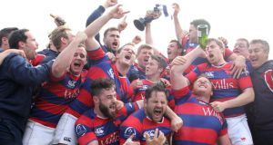 Clontarf's players and backroom staff celebrate after they claimed their first Ulster Bank League Division 1A title with a victory over Ballynahinch at Castle Avenue on Saturday. Photograph: Colm O'Neill/Inpho