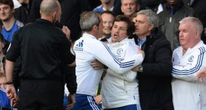 Chelsea manager Jose Mourinho helps hold back assistant coach Rui Faria (centre) after he was sent off by referee Mike Dean  during their  Premier League  match against Sunderland at Stamford Bridge. Photograph:  Philip Brown/Reuters