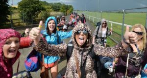 Ciara Brennan from Tipperary, Katie Keel from Clonmel and Chloe Murphy (centre) from Waterford, arriving to Punchestown at the start of Oxegen last year. Photograph: Alan Betson
