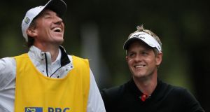 Luke Donald  laughs with his caddie on the 16th tee  during the third round of the RBC Heritage at Harbour Town Golf Links  in Hilton Head Island, South Carolina. Photograph: Tyler Lecka/Getty Images