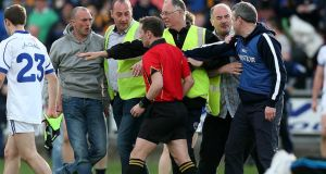 Cavan manager Peter Reilly confronts referee Derek O'Mahoney at the end of the All-Ireland  Under 21 Football Championship semi-final at O'Moore Park in  Portlaoise. Photograph: Donall Farmer/Inpho