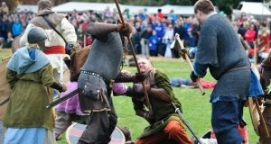 Take that, foe: Viking re-enactors stage the Battle of Clontarf at a festival in St Anne's Park at the  weekend. Photograph: Aidan Crawley