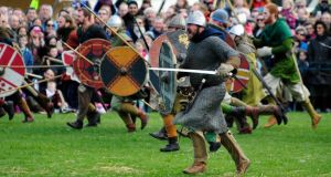 Viking fans in full regalia engage in  mock hand-to-hand combat at one of several re-enactments of the Battle of Clontrarf at a festival in St Anne's Park at the weekend. Photograph: Aidan Crawley