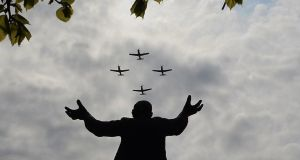 The Air Corps fly past over the Jim Larkin Statue at the GPO today. Photograph: Cyril Byrne/The Irish Times