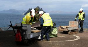 Air Corps crew and OPW workers remove a delivery of stone from the helipad on Skellig Michael. Photographs: David Sleator