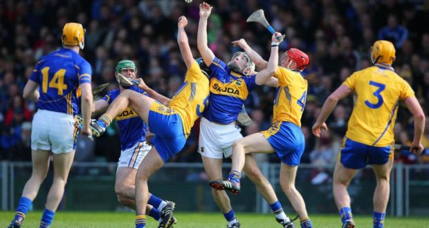 Clare's Brendan Bugler and Jack Browne and  Niall O'Meara of Tipperary battle for possession during the Allianz Hurling League Division One semi-final at the  Gaelic Grounds in Limerick. Photograph:  Cathal Noonan/Inpho