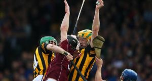 Kilkenny's John Power catches a high ball over Ronan Burke and Johnny Coen of Galway during the National League semi-final at the Gaelic Grounds, Limerick. Photograph: Cathal Noonan/Inpho
