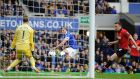Everton's Kevin Mirallas scores his side's  second goal past Manchester United goalkeeper David De Gea during the  Premier League match at Goodison Park. Photograph: Martin Rickett/PA
