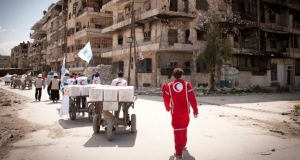 A United Nations High Commissioner for Refugees and Syrian Arab Red Crescent team arrives to the Bustan al-Qasser neighbourhood in Aleppo, which is controlled by opposition forces. Photograph: EPA/UNHCR