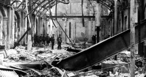 Soldiers survey the interior of the destroyed GPO during the Easter Rising of 1916. Photograph: Hulton Archive/Getty Images