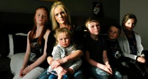 Charlene Murray from Shankill, Co Dublin, with her five children: Casey (12), Zara (10), James (8), Kealum (4) and Skye (4). The family have been living in a hotel in Citywest for the past three months. Photograph: Aidan Crawley