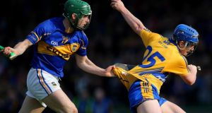 Clare's Padraic Collins is halted by  Cathal Barrett of Tipperary. Photograph: Cathal Noonan/Inpho