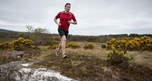 Brendan Daly running at Lough Graney in East Clare. Photograph: Eamon Ward