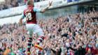 Burnley's  Michael Kightly  celebrates scoring their second goal during the  2-0 Championship victory over Wigan Athletic at Turf Moor that guarantees them automatic promotion back to the Premier League. Photograph: Chris Brunskill/Getty Images