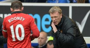Manchester United manager David Moyes speaking to Wayne Rooney during their clash with Everton. Photograph: Peter Powell/EPA
