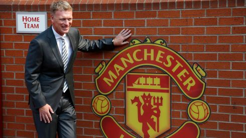 Happier times: Manchester United manager David Moyes poses in front of the home team dugout before a news conference at Old Trafford days after he was appointed in  July  2013. Photograph: Phil Noble/Files/Reuters