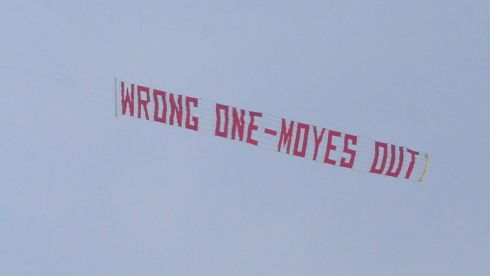 A plane flies overhead with a banner during a  match between Manchester United and Aston Villa at Old Trafford on March 29th, 2014 as criticism of David Moyes grew. Photograph: Alex Livesey/Getty Images