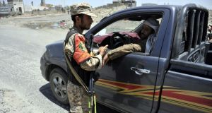 A Yemeni soldier checks a pickup car at a checkpoint in the country's capital, Sana, as authorities tighten security measures. Photograph: EPA/Yahya Arhab