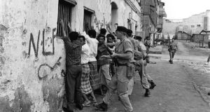 4th April 1967:  Soldiers of the Northumberland Fusilier regiment force Arab demonstrators against a wall during nationalist terrorist attacks aiming to expel British forces from South Arabia. Aden became the capital of the People's Republic of Southern Yemen in 1967.  (Photo by Terry Fincher/Express/Getty Images)