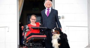 President Michael D Higgins, accompanied by Shadow, one of his two Bernese Mountain Dogs, greeting Joanne O'Riordan at Áras an Uachtaráin. Photograph: Eric Luke