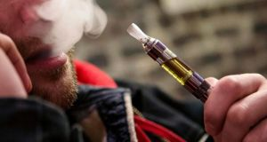 A customer puffs on an e-cigarette at the Henley Vaporium in New York City. Photograph: Mike Segar/Reuters