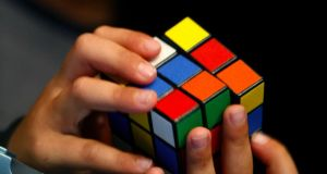 "The exhibition Beyond Rubik's Cube is ""not about the cube. It's about the intersection of engineering, that brilliant mechanism inside the cube; design, of course the colours of it, and mathematics - that 43 quintillion possibilities"". Photograph: Laszlo Balogh/Reuters"