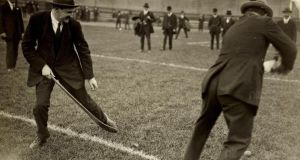 Michael Collins and Harry Boland play hurling at Croke Park on the day of a Leinster Hurling final - an image published in September 1921. Photograph: Piaras Béaslaí Collection/NLI