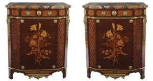 A pair of mahogany and marquetry commodes, each 76cm wide by  François Linke,  circa 1900,    €140,000-€180,000, at Sheppard's