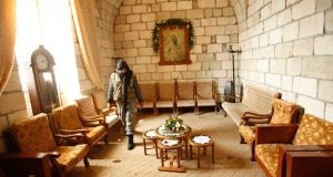 A rebel fighter from the Islamic Front in a church in the Armenian Christian town of Kessab. Photograph: Ammar Abdullah/Reuters