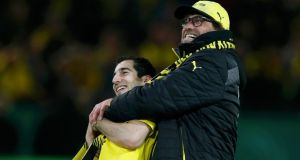 Borussia Dortmund's coach Jurgen Klopp (right), seen here with attacker Henrikh Mkhitaryan, has again ruled him out of the running for the Manchester United job. Photograph: Wolfgang Rattay / Reuters