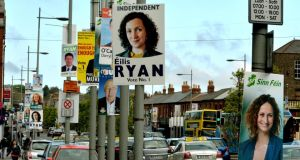 Election posters in Dublin; one candidate had to remove a poster covering traffic lights on Custom House Quay. Photograph: David Sleator/The Irish Times