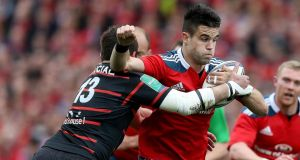 Munster's Conor Murray is tackled by Florian Fritz of Toulouse during the Heineken Cupquarter-final at Thomond Park. Photo: Dan Sheridan/Inpho