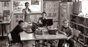Theresa McGuigan, teacher, in her school on Inishturk, which comprises just three children  Ryan, Nathan, and Katelyn Heanue.