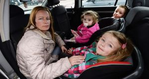 Sabrina McMahon with her children Karl (5), Chelsea (1) and Michaela (3) in the car where they are staying in Tallaght, Dublin. Photograph: Cyril Byrne