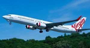 A Virgin Australia flight has landed safely in Bali after the pilot initially reported a hijack' attempt.